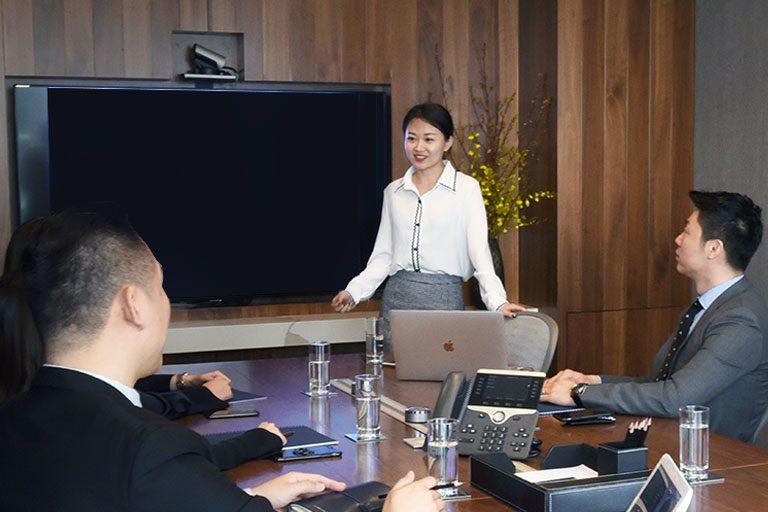 TEC members having meeting in conference room