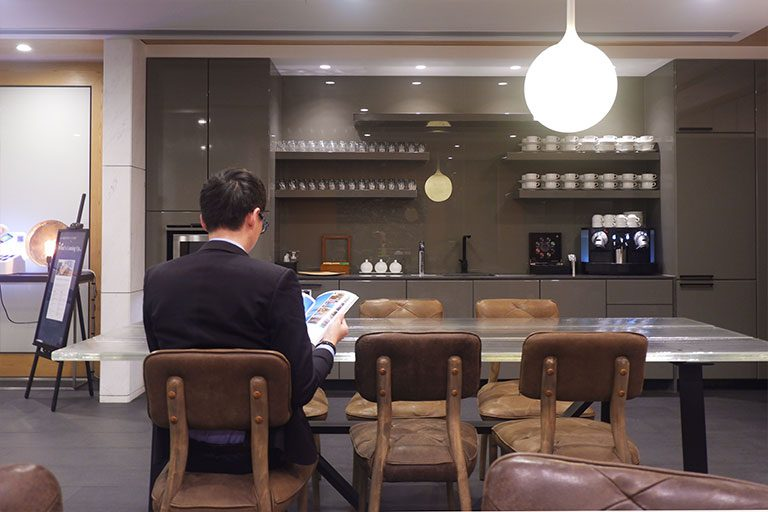 a man reading at the lounge area offered to virtual office clients