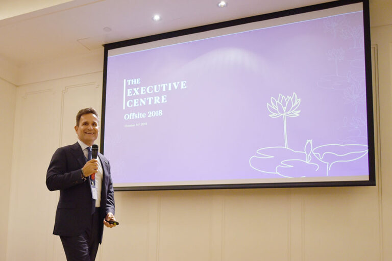 Paul giving a presentation to share the company's growth