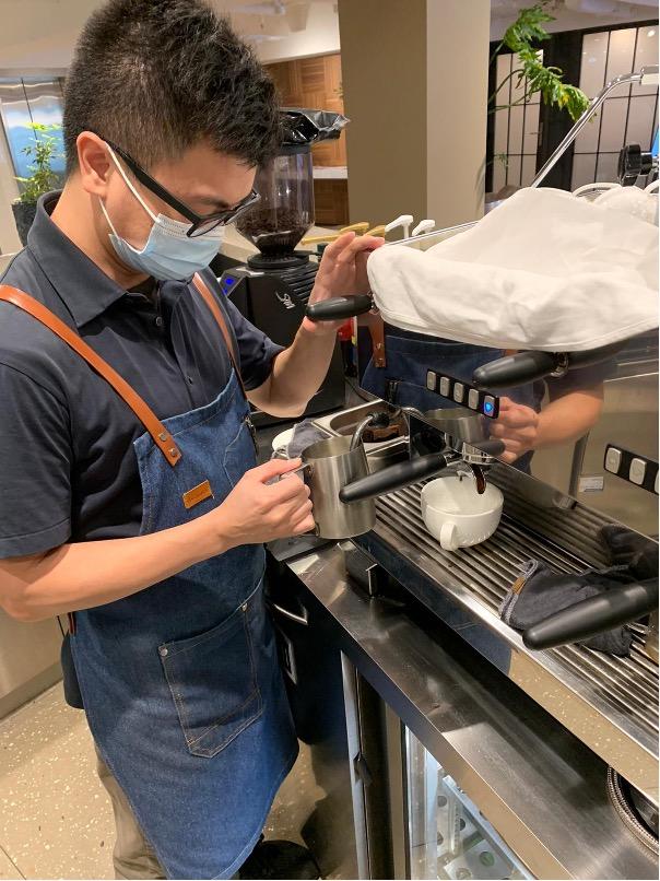 Barista Ivan making premium coffee for TEC office space members