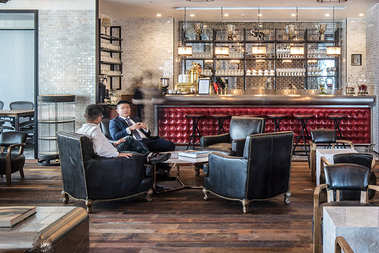 two men sitting at lounge area at the coworking space of TEC